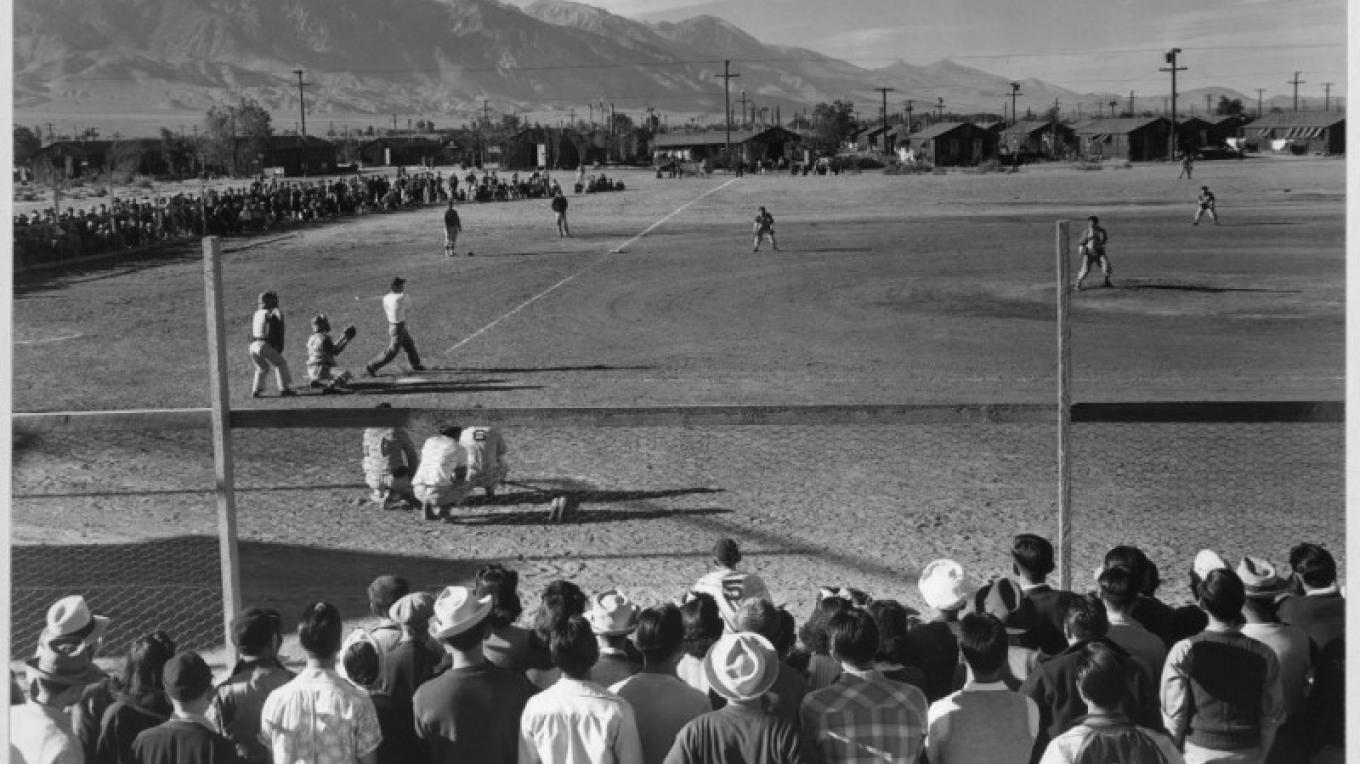 The all-American pastime of baseball was popular in Manzanar. The internees formed their own leagues and played in front of large crowds. – Ansel Adams, Library of Congress