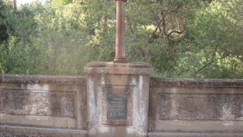 Dedication plaque on Old Highway 49 bridge on Harvard Mine Road. – John Gurney