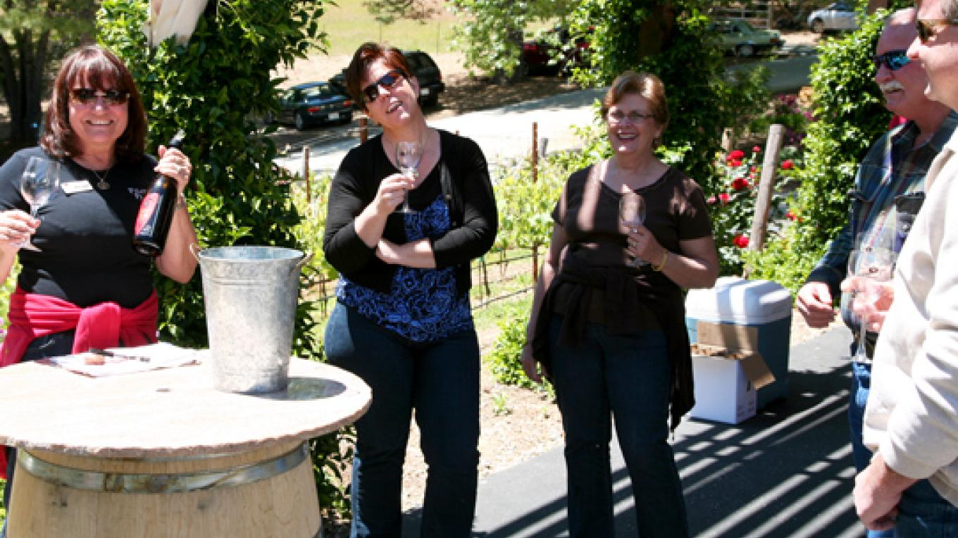 Pouring wine at an event – Lynn Wilson