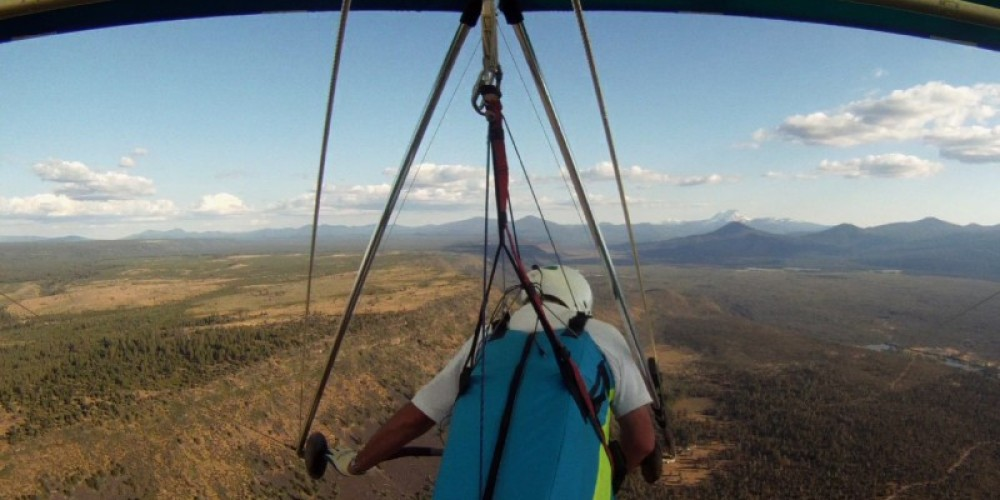 Phil Sergent of the Shasta Sky Sailors, a Shasta county hang gliding and paragliding club, in flight over Hat Creek Rim. The camera was attached to his hang glide. – Phil Sergent