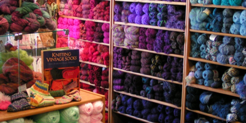 Yarns arranged by color, as shown in former location of Creekside Yarns – Jana Botkin