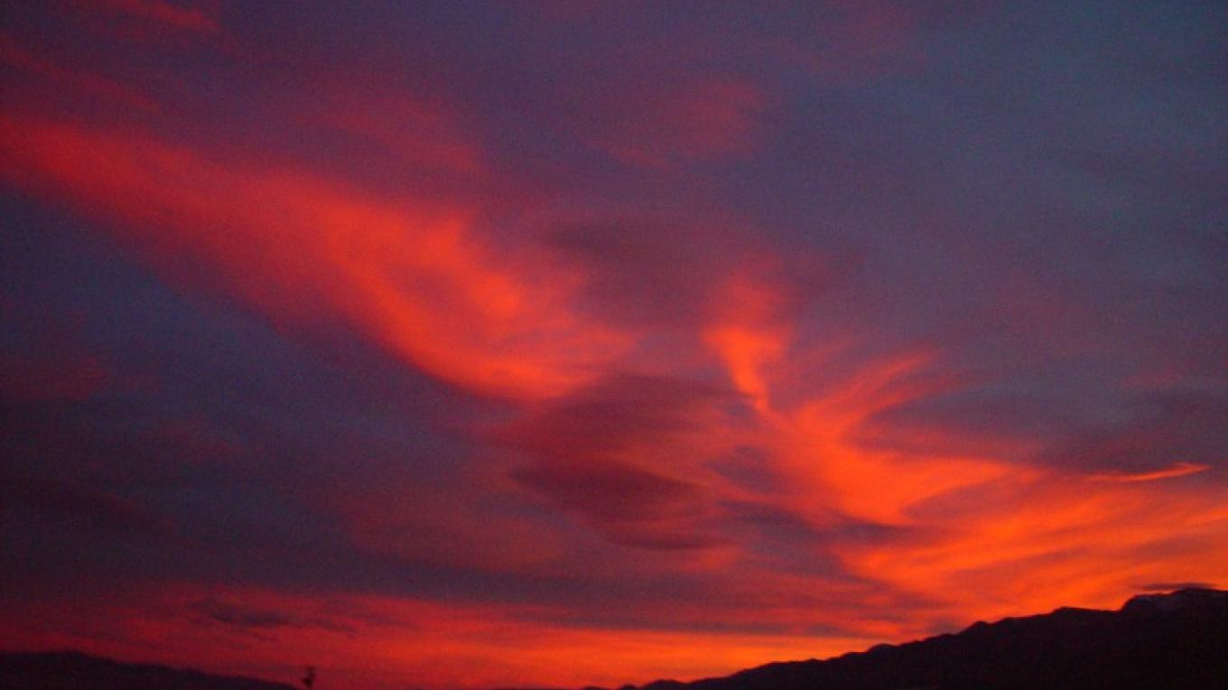 Red morning skies bring a spectacular end to night time viewing in the dark skies of Modoc. – Jean Bilodeaux
