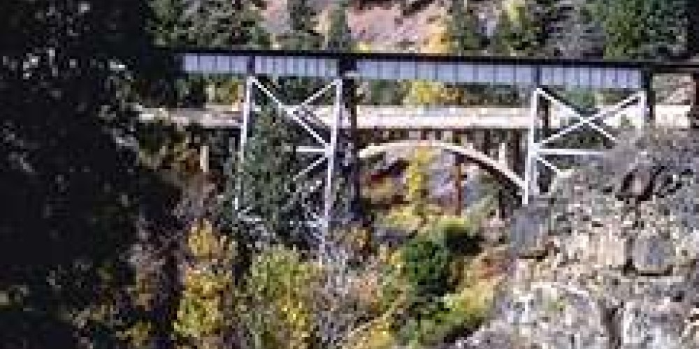 Splashes of fall color near one of 11 bridges along the Bizz Johnson Trail. – BLM Eagle Lake Susanville