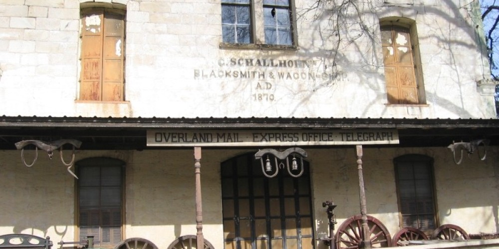 The Schallhorn building is the largest of several blacksmith shops and livery stables that were once on Main Street. – Elaine Zorbas
