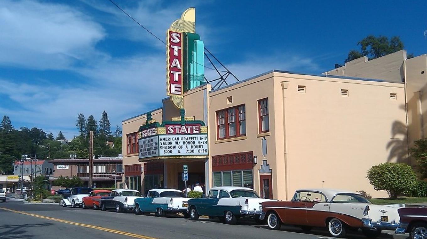 The facade of the State Theatre on Lincoln Way is flanked by 1950's automobiles during a screening of American Graffiti. – Jim Lerch