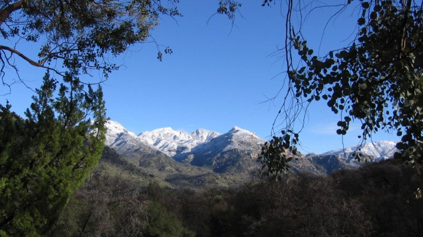 snow covered mountains behind the retreat center