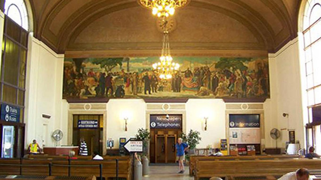 A station mural depicts the 1863 groundbreaking ceremony of the Central Pacific Railroad. – Amtrak