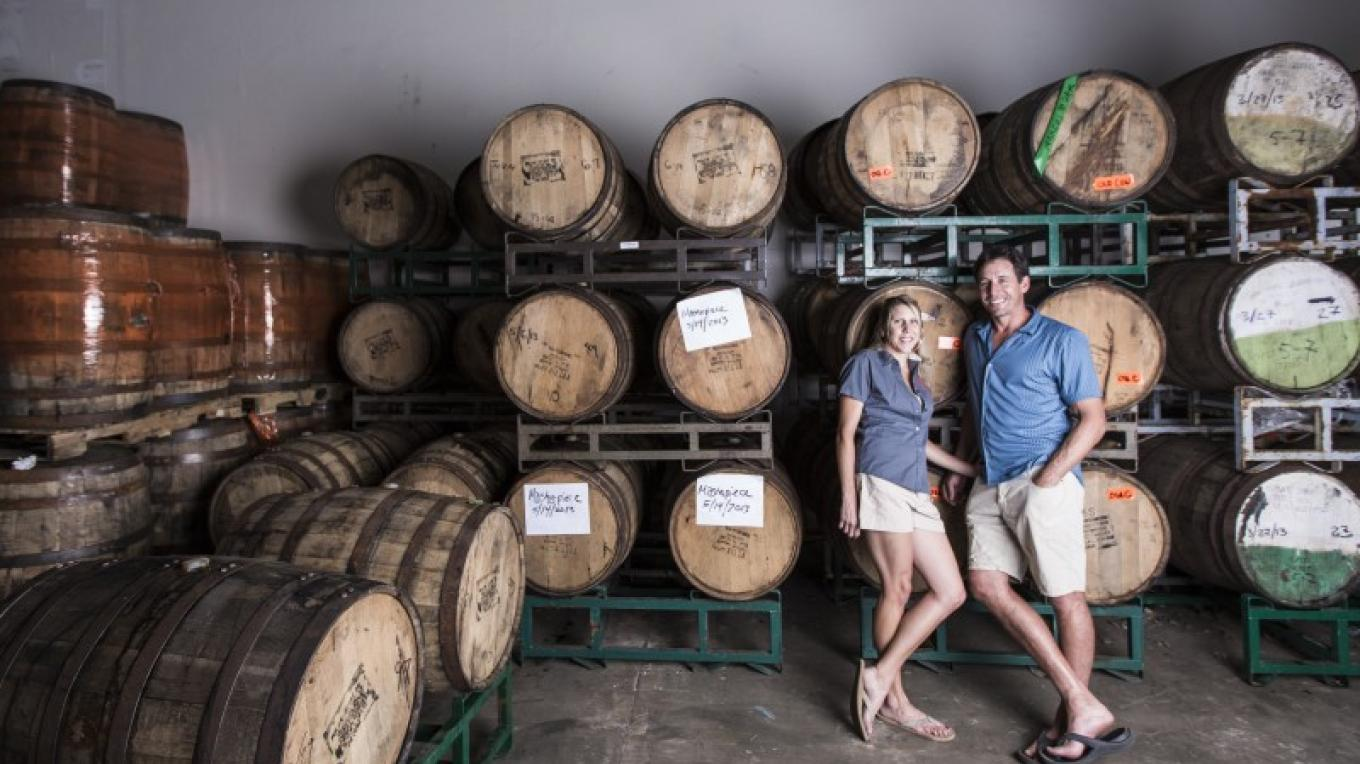 "Owners Andy & Alicia Barr in the ""Barrel Room"". – Jamie Kingham"