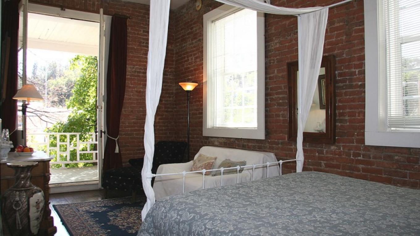 Guest room in historic hotel hotel.  Rooms at the front of the hotel have french doors that open onto the hotel balcony overlooking the town of Amador City. – Christine Gustafson