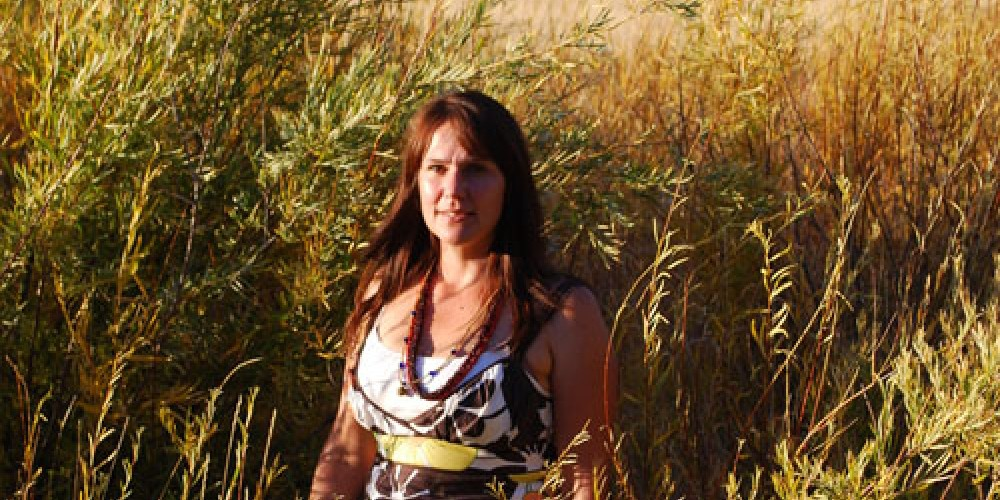 Ms. Cunningham, hike leader, surrounded by willows that are especially good for weaving baskets. – Karen Kleven