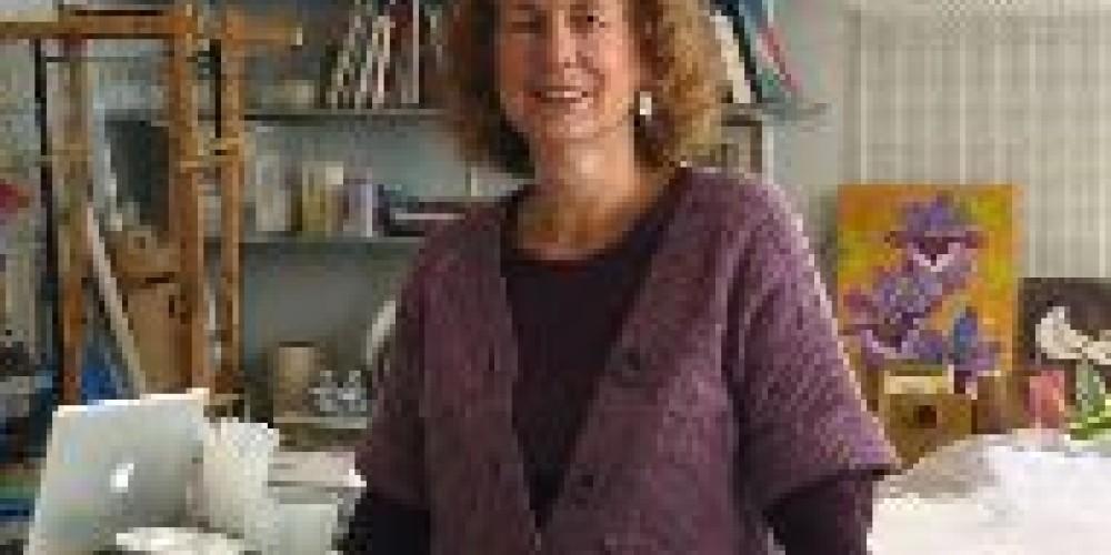 Meridee Smith beams in her well-lit studio.