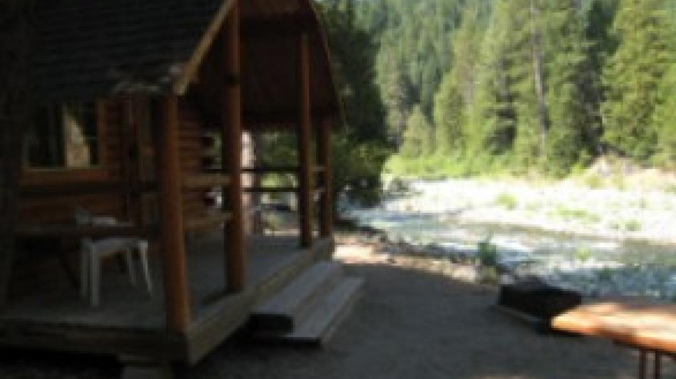One of our 8 Log Camping Cabins on the river. – Zolldan Family