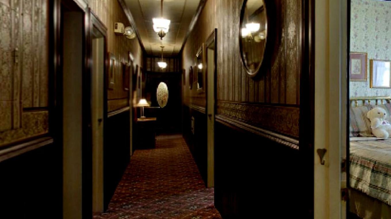 Upstairs hallway with doorways to rooms. – Enrich Media, Inc