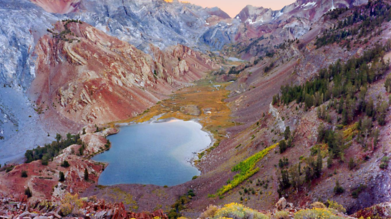"Sunset at Lake Mildred (9,800 ft) and Red Slate Mtn (13,100 ft) in the John Muir Wilderness Area. John Muir said that of all the Sierra's features ""none more surely charm and surprise... than the glacier lakes."" – Fred Weyman"