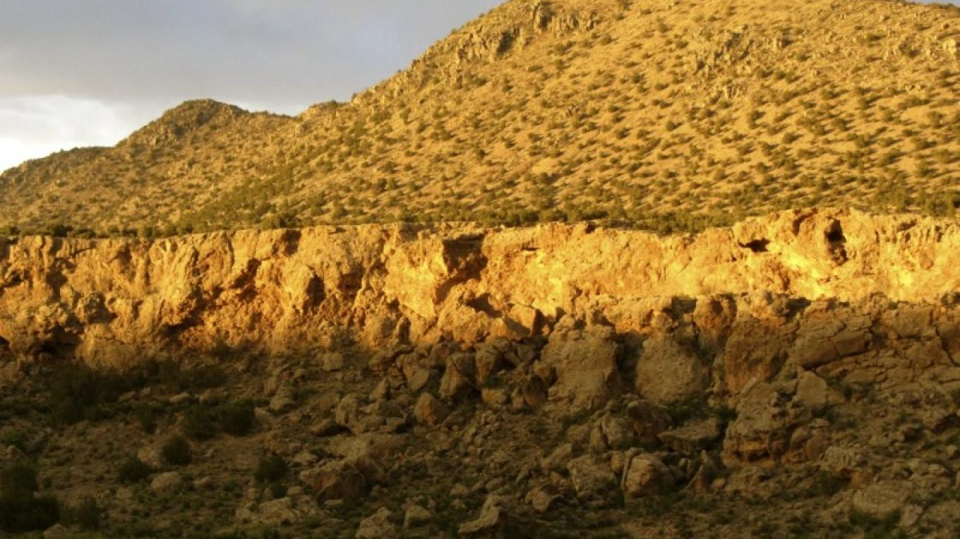Cerro Tecolote and the cliffs at sunsets.  This view is seen from most places on the land. – H. Atterbury