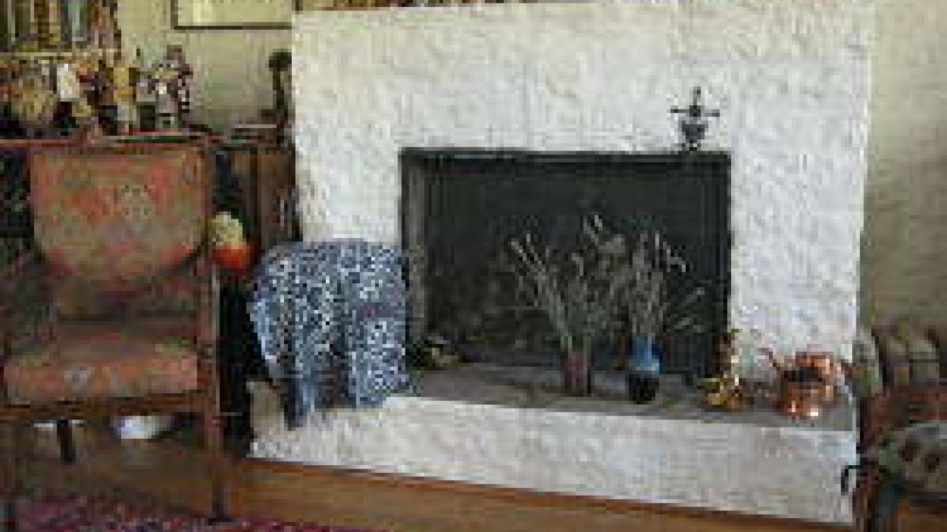 Large fireplace in the living room of the Oppenheimer House – Larry Campbell