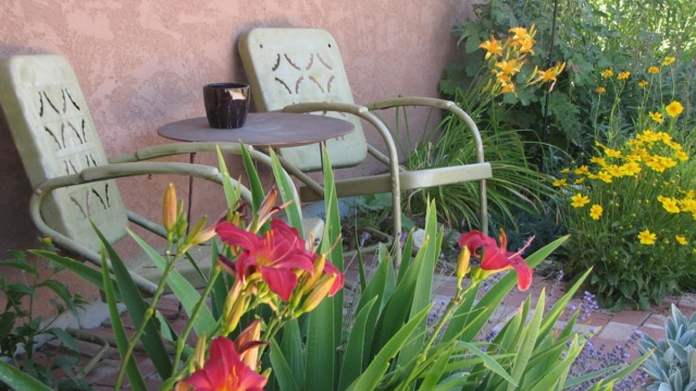 Lovely rear seating where you can enjoy a glass of wine or a cup of coffee while enjoying the gardens and the light playing across the mesa – Rebecca Brunk