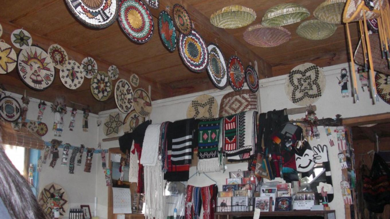 Traditional Hopi Katsina dolls, baskets, and ceremonial textiles in the trading post – Joseph Day