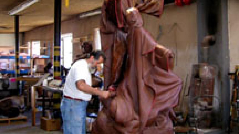 Huberto working on clay sculpture – Dana Maestas