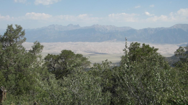 Overlooking the San Luis Valley and the San Dunes – Sharron Calvin