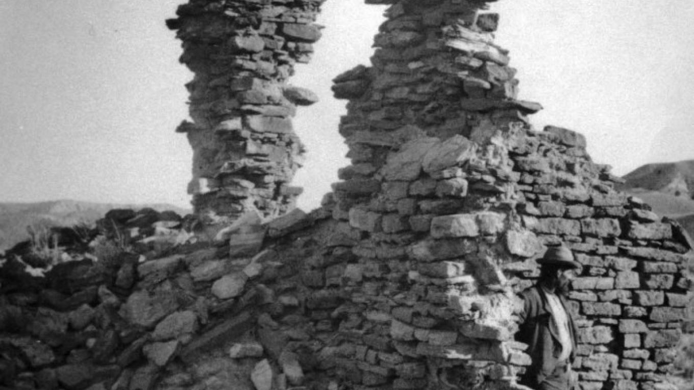 Salmon Ruin, 1874.  Before the area was opened to homesteading, Timothy O'Sullivan, seen here, photographed the third story of the unexcavated pueblo. – Photo Courtesy Smithsonian Institution