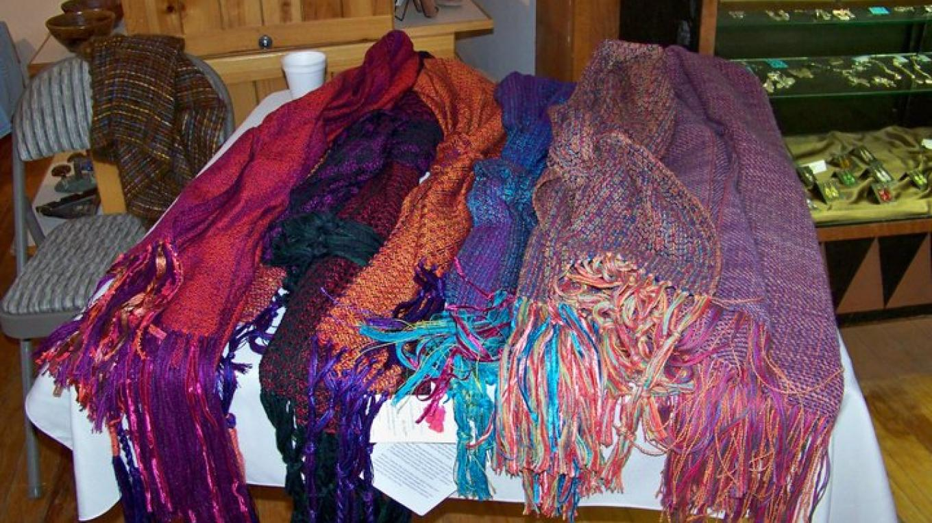 Beautiful handcrafted scarves by a member of the El Morro Traditional Crafters. – J. Rossignol