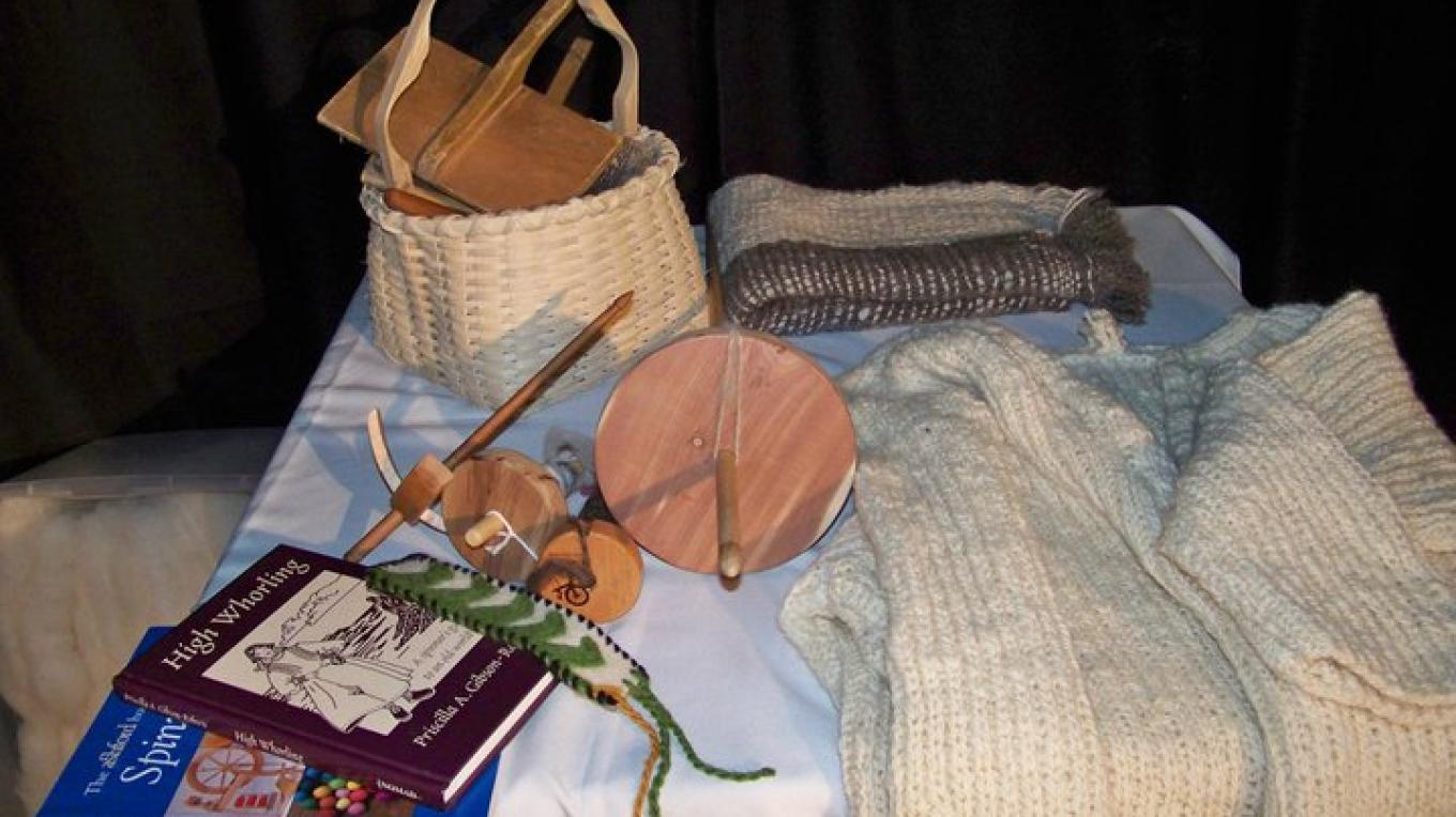 A wool spinning and knitting exhibit at the Annual Fiber Arts Festival at the Old School Gallery – J. Rossignol