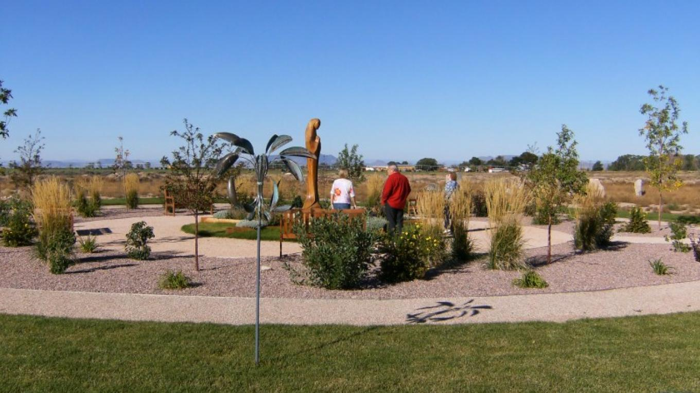 Visitors enjoying the peacefulness of Mother Mary's Garden. – by Susan Sanderford
