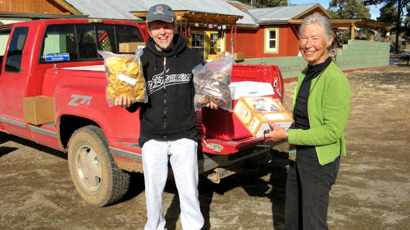 El Morro Valley Cooperative volunteers Jill Acheson and Jim Janko delivering natural food orders to members of our Buyer's Alliance – Kirk Shoemaker