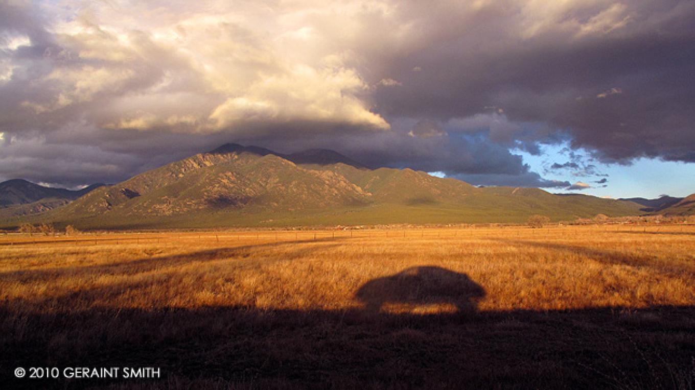 Evening shadows and Taos Mountain storm – Copyright © 2010 Geraint Smith