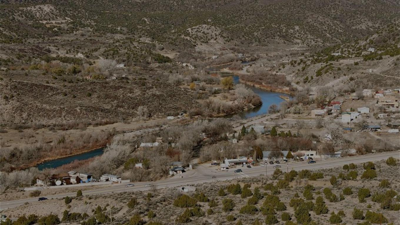 View of the Pilar Yacht Club, the Rio Grande Gorge, and the bend in the Rio Grande River. – Georg Behrens