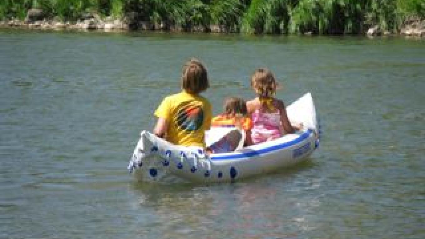 Playing with inflatable boats at the campgrounds – Maggie Evans