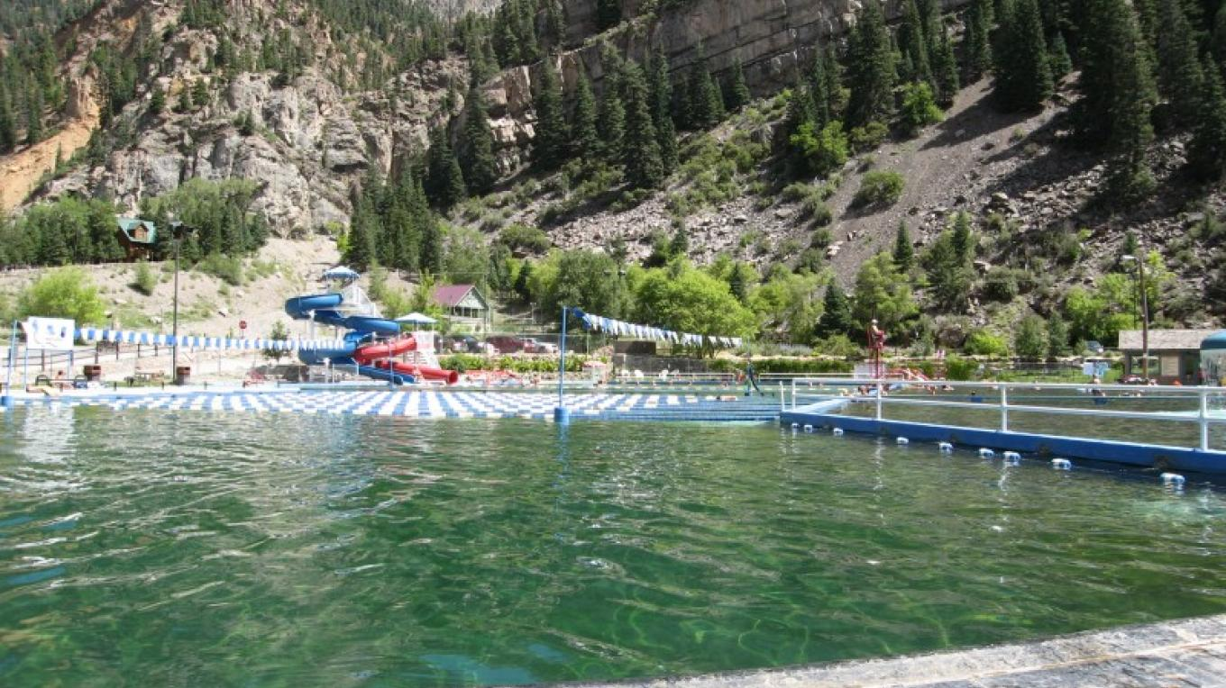 One of the largest natural hot sprngs pools in Colorado, the Ouray pool is nestled snugly in the San Juan Mountains – R Noll