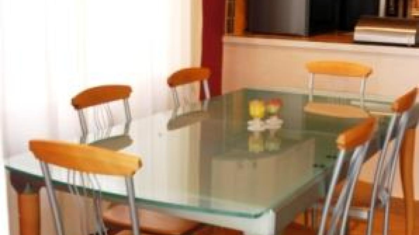 Italian glass top table expands to seat 8
