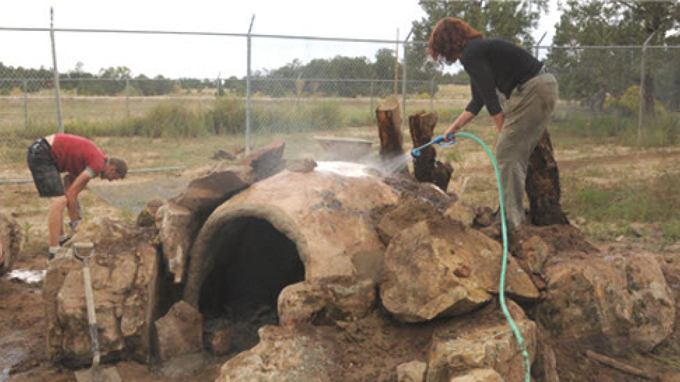 Volunteers cleaning one of the wolves dens at Wild Spirit Wolf Sanctuary – wsws
