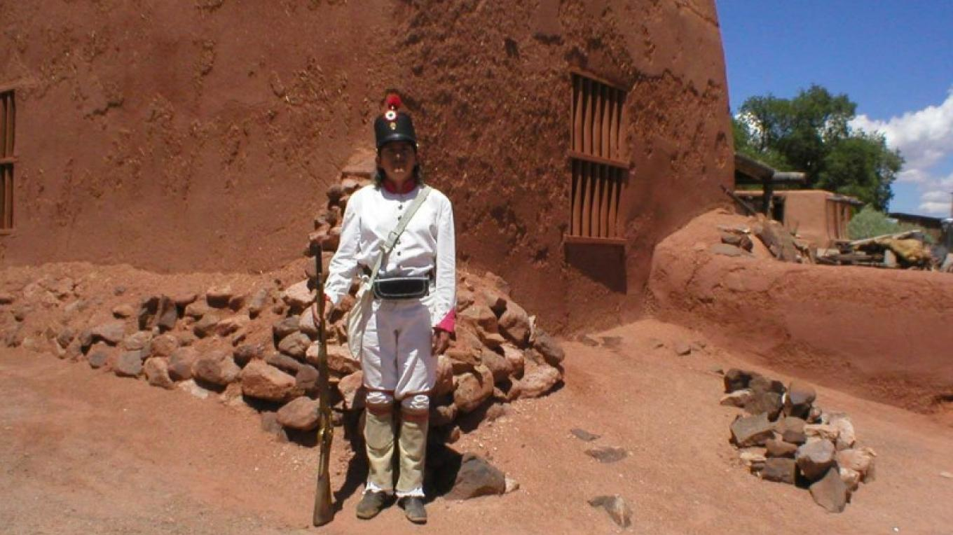 Adobe buildings and a soldier of the early 19th century Mexican era. – Roberto Valdez