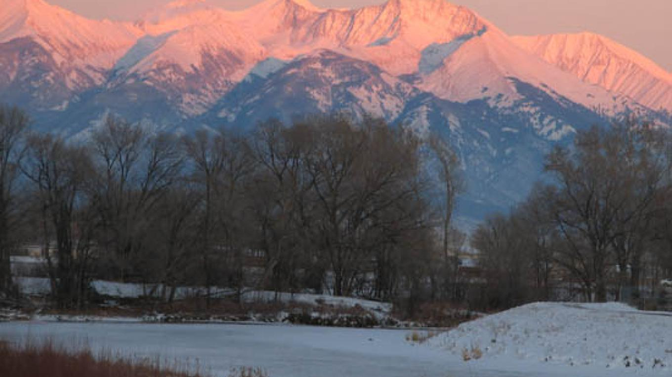 The Rio Grande travels through Alamosa and provides a great walking trail. Blanca Peak illustrates how the Sangre de Cristo National Heritage Area got its name (it means blood of Christ). – Marilyn Loser