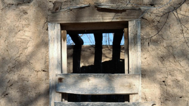 Window on an abandoned plaza building – Don J. Usner