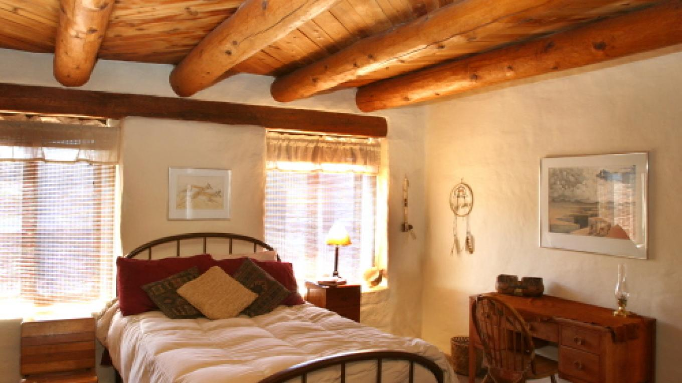 One of four comfortable, southwestern style guest bedrooms – M. Merrill