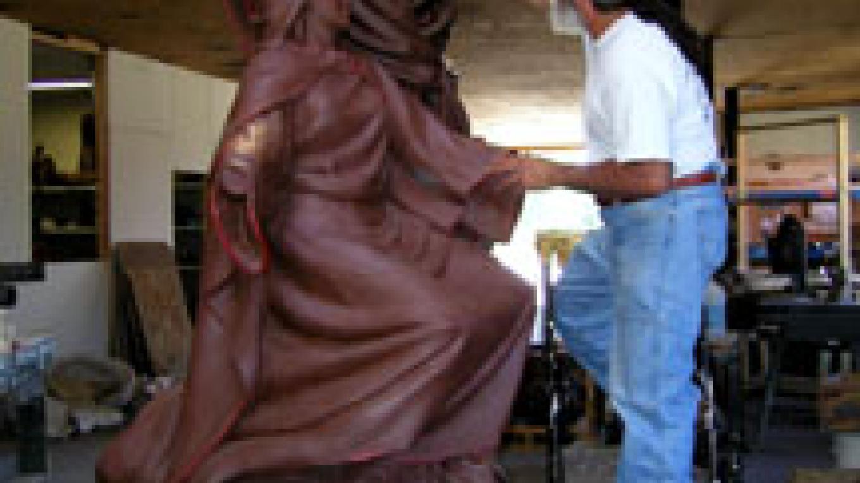 Huberto sculpting clay model of the Coronation of Mary – Dana Maestas