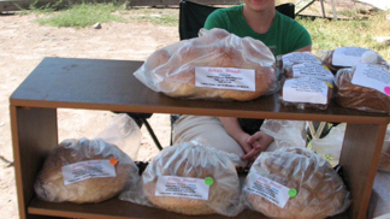 Hand made bread from local, organic flour is one of the Saturday Markets favorite treats. – M. Diane Bairstow