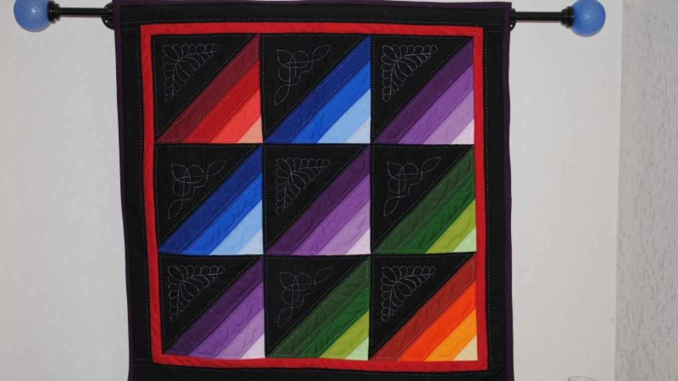 Multi-color quilted wall hanging – Jake LaFore