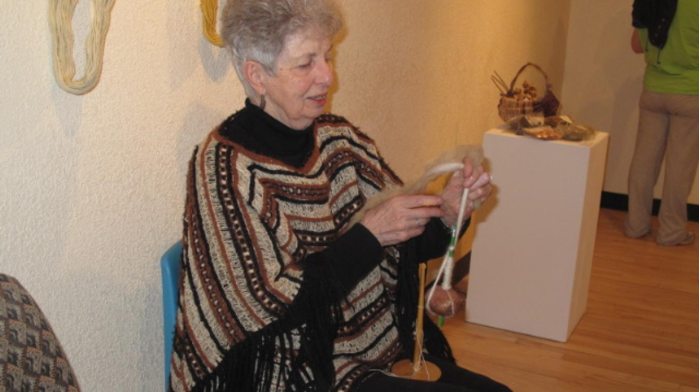 Arvella Weldon demonstrating the art of spinning wool. – Mary Jo Martin