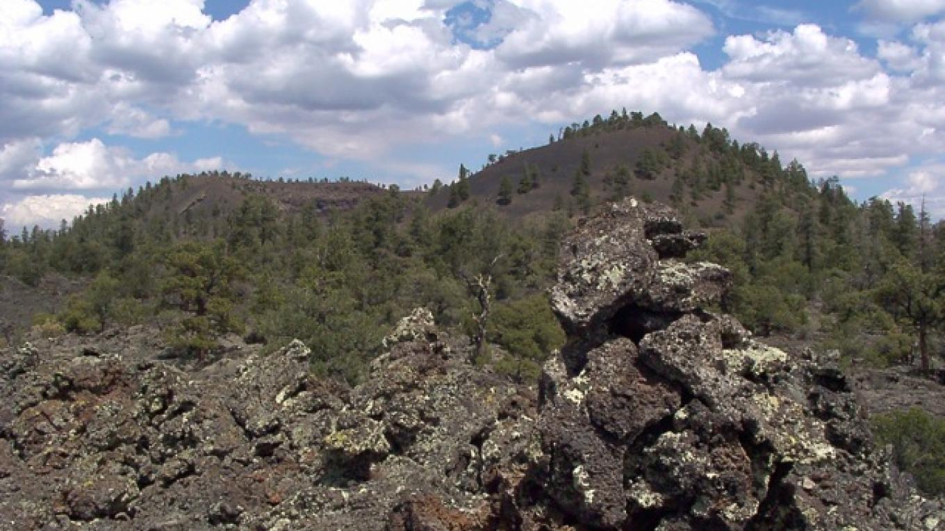 View of the Bandera Volcano from her lava field with ancient Anasazi cairn in the foreground – Jeff Alford