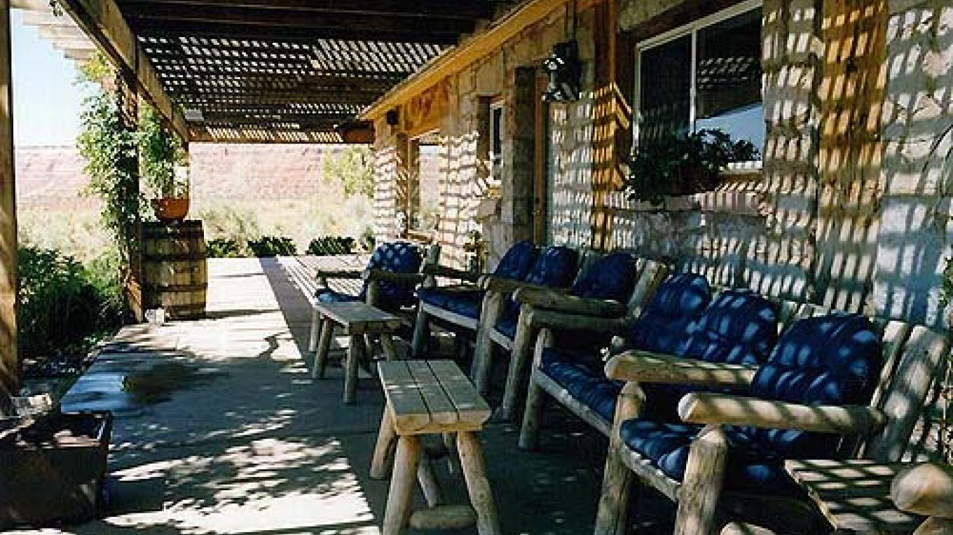 the shady porch provides a cool place to relax after a day hiking. – Valley of the Gods B&B