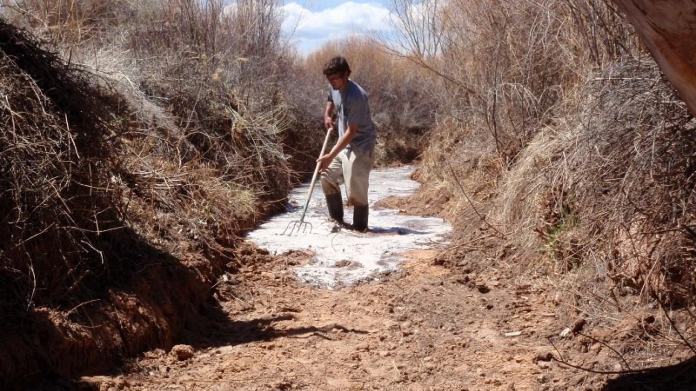"""walking the water"" in the acequia madre at the beginning of irrigation season – Timothy Seaman"