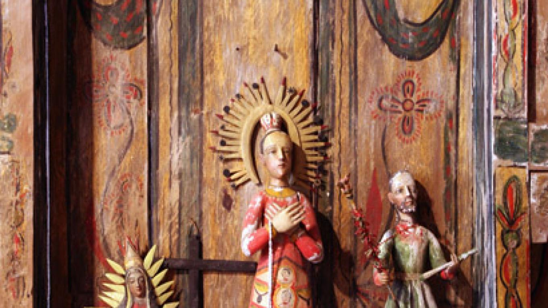 Bultos (carvings of saints). – Richard L. Rieckenberg