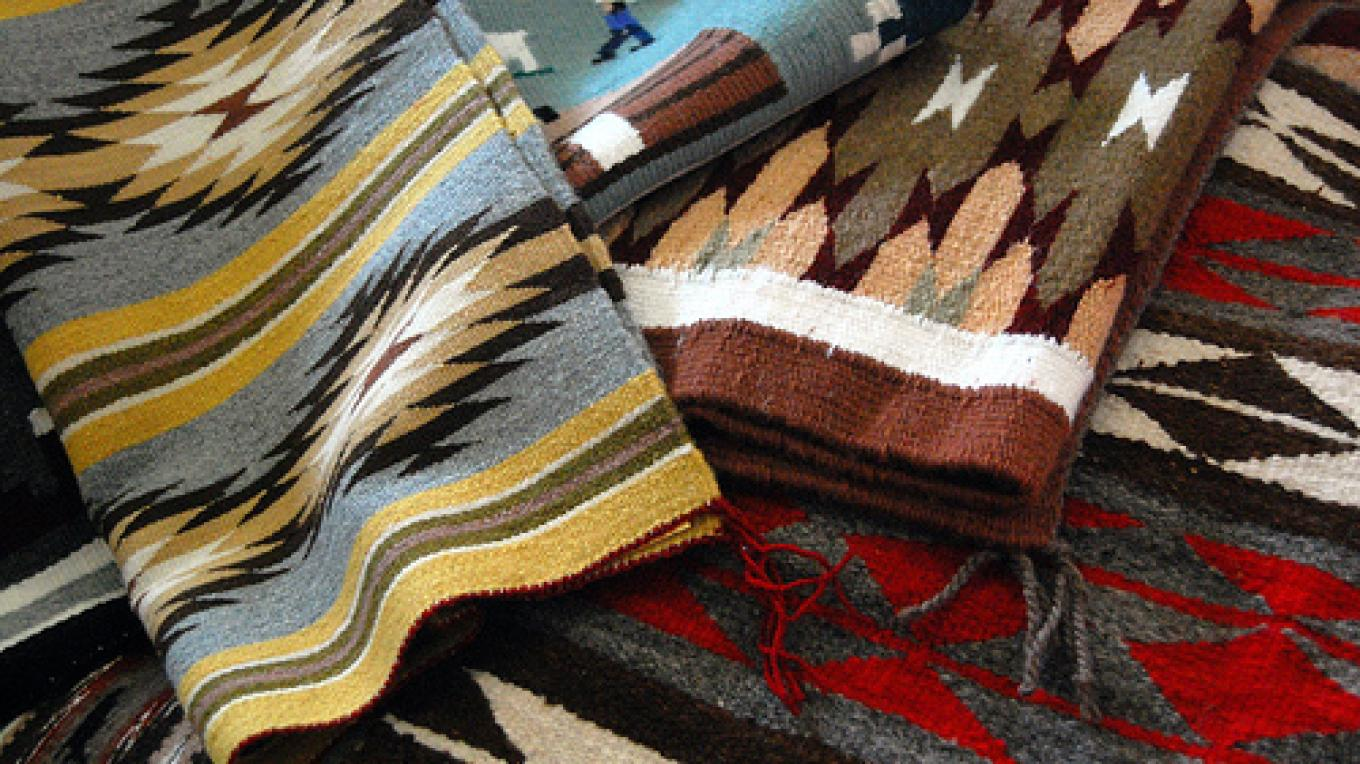Stack of Navajo Rugs for Auction – J. Stone