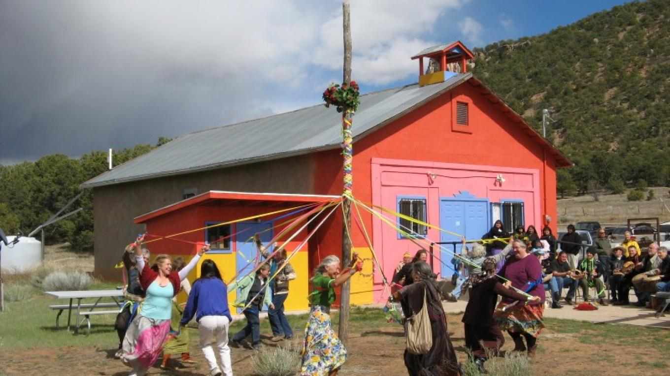 Happy El Morro Valley residents dance around the Maypole to celebrate May day and the coming of Spring on May 1st at the Old School Gallery – Kirk Shoemaker