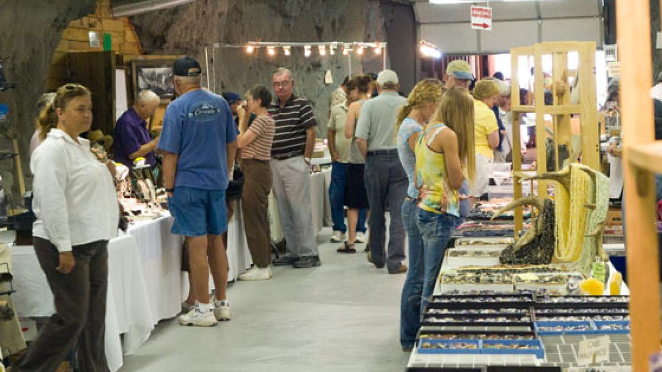 "Vendors and spectators in ""the cave,"" in the Creede Community Center – Kara Brittain"